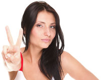 Brunette girl shows peace hand sign isolated Royalty Free Stock Photography