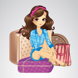 Brunette Girl Sitting On Suitcases Royalty Free Stock Image