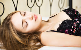 Brunette girl sleeping in bed Royalty Free Stock Photo