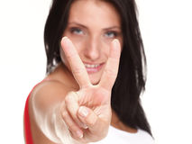 Brunette girl smile shows you peace sign isolated Stock Image