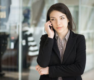 Brunette girl speaking by phone. Royalty Free Stock Photo