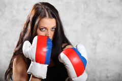 Brunette girl stand in boxing rack Stock Photos
