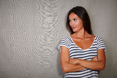 Brunette girl standing with arms crossed Stock Photo