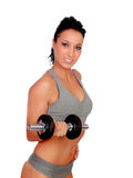 Brunette girl stimulating their fitness with dumbbells stock image