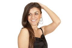Brunette girl straightens her hair Stock Photos