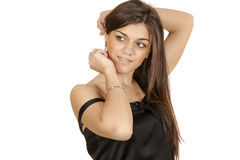 Brunette girl straightens her hair Stock Photo