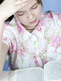 Brunette Girl Studies Bible  Stock Photos