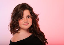 Brunette girl in the studio. Beautiful young tubby brunette girl in studio Stock Photography