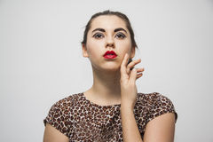Brunette girl with stylish makeup looking above Stock Photography