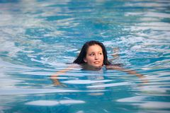 Brunette girl in swimming suit Royalty Free Stock Photos