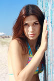 Brunette girl in swimsuit stands near building Stock Image