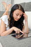 Brunette girl with tablet pc Royalty Free Stock Image