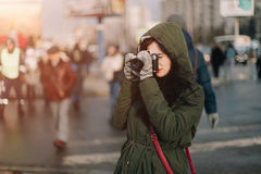 Brunette girl taking retro camera and focusing on somebody Royalty Free Stock Photo