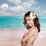 Brunette girl in tropical beach with daisy flower happy Stock Photo
