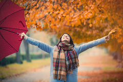Brunette girl with umbrella Stock Images