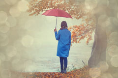 Brunette girl with umbrella Royalty Free Stock Photo