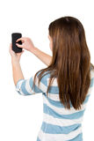 Brunette Girl using a Smartphone Stock Photography