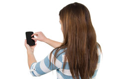 Brunette Girl using a Smartphone Stock Image