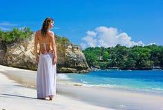 Brunette girl walking on beach Stock Photography