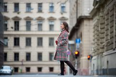 Brunette girl is walking down the street in Budapest Stock Images