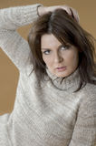 Brunette girl in a warm wool sweater. Stock Images