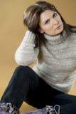 Brunette girl in a warm wool sweater. Stock Photo
