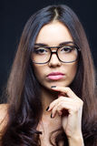 Brunette girl wearing glasses Stock Photography