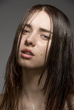 Brunette girl with wet face Stock Images