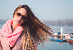 Brunette girl with wind in her hair Stock Photography