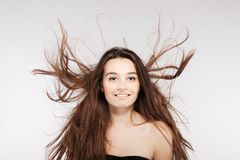 Beautiful brunette girl with windy hair. Brunette girl with windy hair looking at camera Royalty Free Stock Photos