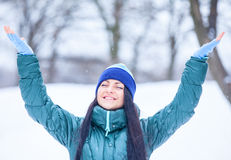 Brunette girl in the winter park. Royalty Free Stock Image