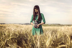 Free Brunette Girl With Retro Camera In Meadow Stock Image - 32037721