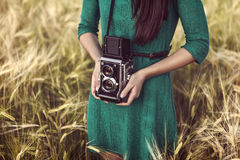 Free Brunette Girl With Retro Camera In Meadow Royalty Free Stock Photo - 32037755