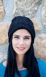 Brunette girl with wool cap and piercing Royalty Free Stock Photos
