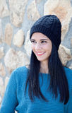 Brunette girl with wool cap and piercing Royalty Free Stock Photography