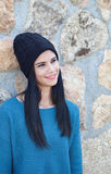 Brunette girl with wool cap and piercing Stock Photo
