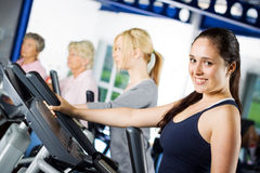 Brunette girl working out Stock Photos