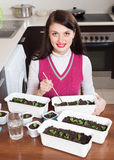 Brunette girl working with  seedlings Stock Image