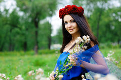 Brunette girl with a wreath on his head Royalty Free Stock Images
