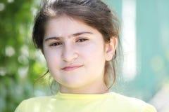 Brunette girl in yellow shirt Stock Photo