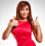 Brunette girl yes woman shows positive sign thumbs Royalty Free Stock Image