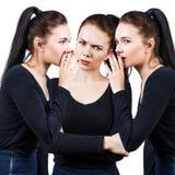Brunette girls telling gossip royalty free stock photography