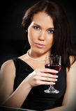Brunette with a glass of wine Stock Photography