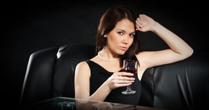 Brunette with a glass of wine Royalty Free Stock Images