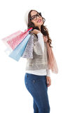 Brunette with glasses holding shopping bags Stock Images