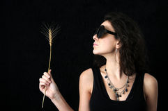 Brunette with glasses and wheat Royalty Free Stock Images