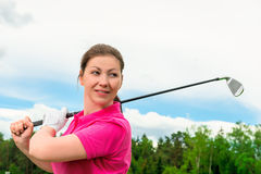 Brunette with a golf club Stock Photos