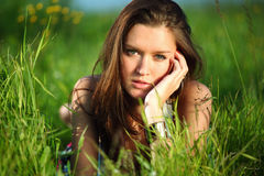 Brunette on grass Royalty Free Stock Images