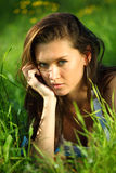 Brunette on grass Stock Image