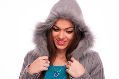 Brunette in the gray sweater with hood Royalty Free Stock Image